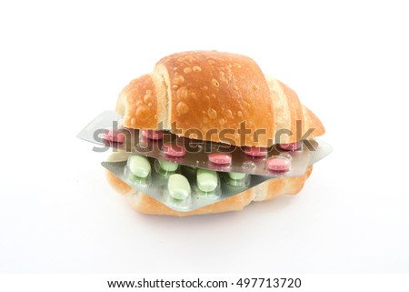 sandwich with pills representing health theme studio isolated