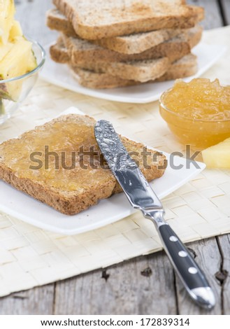 Sandwich with Pineapple Jam on wooden background - stock photo