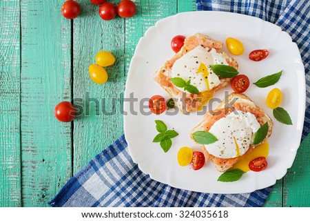 Sandwich with poached eggs with salmon and cream cheese. Top view - stock photo