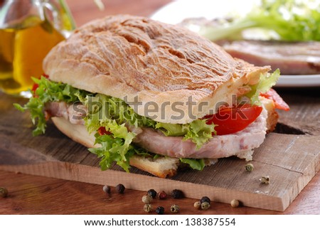 sandwich with pork and vegetables