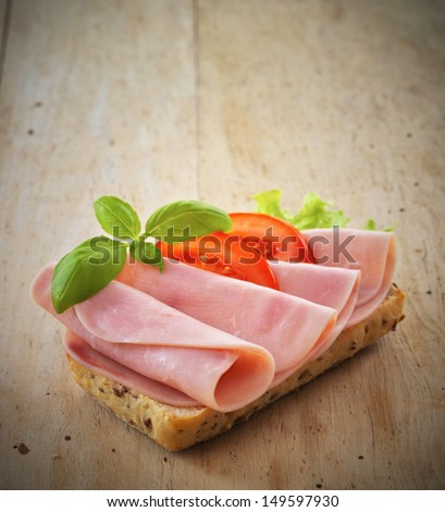 sandwich with pork ham and tomatoes - stock photo