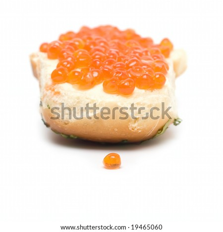 Sandwich with red caviar isolated on white