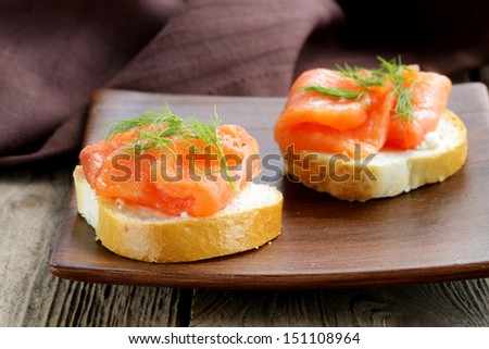 Sandwich with red fish (salmon) and dill