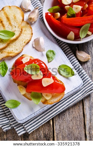 Sandwich with red peppers, garlic and Basil. Selective focus. - stock photo