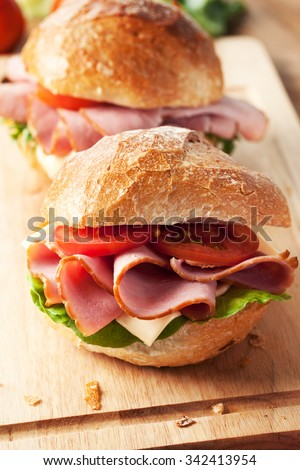 sandwich with roll bread and ham - stock photo