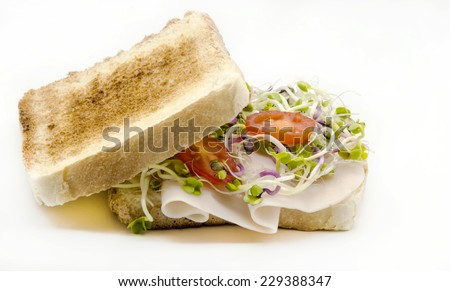 Sandwich with salad and baked ham
