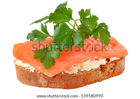 Sandwich with salmon and parsley isolated on white background - stock photo