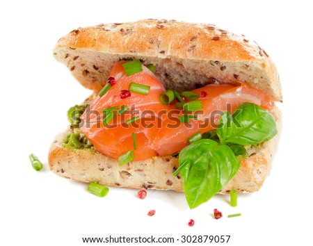 Sandwich with salmon for healthy breakfast isolated on a white. Selective focus