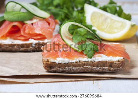 Sandwich with salted salmon and cream cheese,    selective focus - stock photo