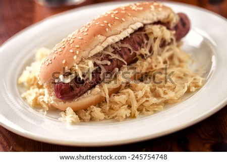 Sandwich with sausage and sauerkraut - stock photo