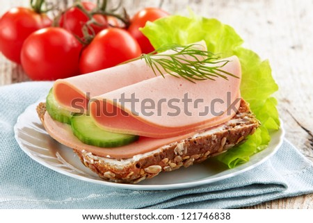 sandwich with sausage slices - stock photo