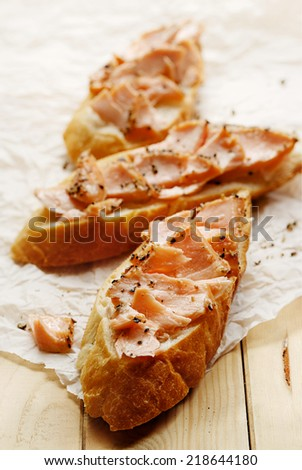 Sandwich with smoked salmon and black pepper - stock photo