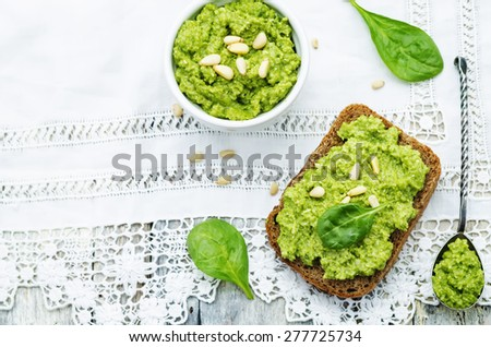 sandwich with spinach pesto on a white background. the toning. selective focus - stock photo