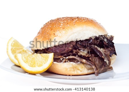 Sandwich with spleen isolated on white. typical Sicilian food. Selective focus with shallow depth of field - stock photo