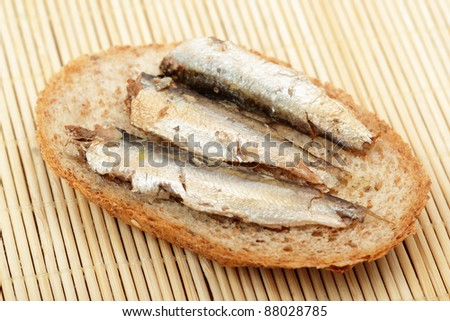 Sandwich with sprats - stock photo