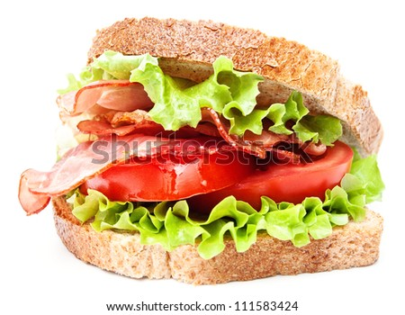 Sandwich with tomato and bacon on wheat bread on white background