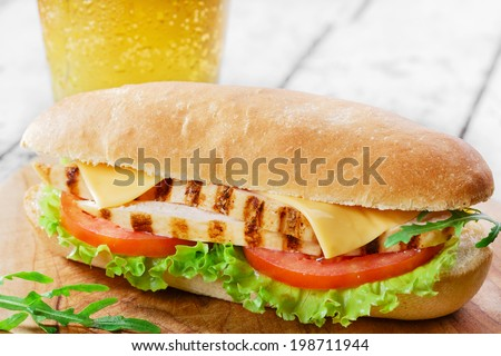 sandwich with tomato and cheese grilled chicken  - stock photo