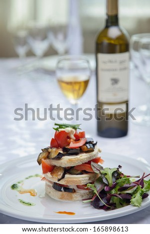 Sandwich with tomato and eggplant on the table