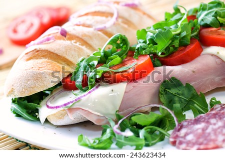Sandwich with tomato, cheese, and ham - stock photo