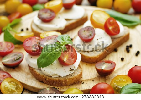 sandwich with tomatoes, Basil and mozzarella. toning. selective focus - stock photo