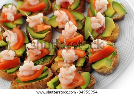 sandwiches  garnish with shrimps, avokado and lettuce close up, snack