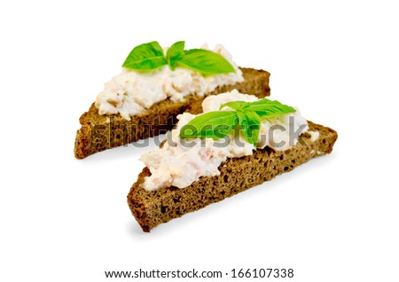 Sandwiches on two pieces of rye bread with cream of salmon and mayonnaise, basil, isolated on white background - stock photo