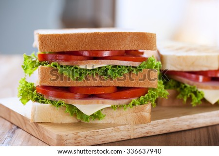 sandwiches on wooden board for breakfast - stock photo