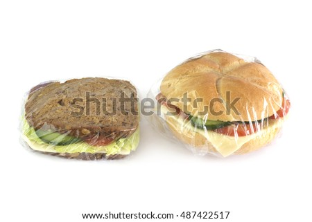 Sandwiches packed with stretch film on white background.