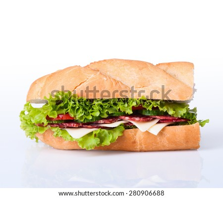 Sandwiches - turkey breast, ham & swiss and salami on a cutting board. Isolated on white background - stock photo