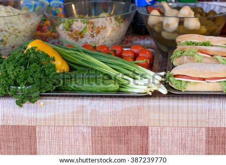 Sandwiches, vegetables on a counter of street trade