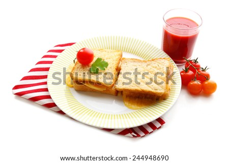 Sandwiches with cheese and tomatoes on plate near glass of juice isolated on white