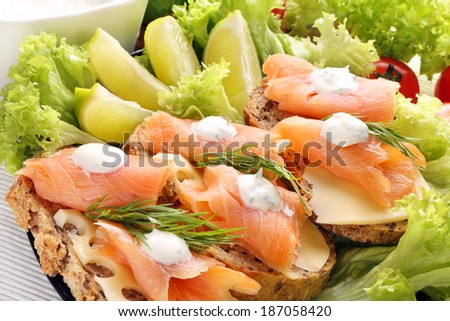 Sandwiches with cheese, salmon and dill dip