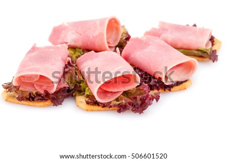 Sandwiches with crackers, bacon and lettuce isolated on white background.