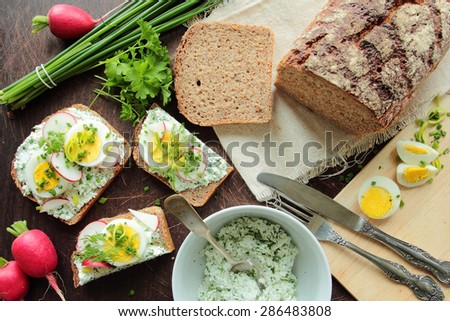 Sandwiches with egg, cheese and radish - stock photo