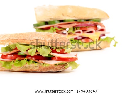 Sandwiches with ham and tomato. Isolated on a white background.