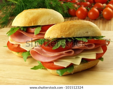 Sandwiches with ham, cheese and vegetables - stock photo