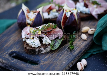 sandwiches with meat, blue cheese and figs - stock photo