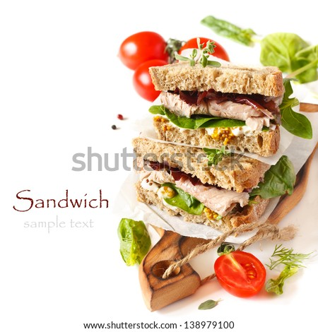 Sandwiches with meet, vegetables and mustard on crusty fresh sliced rye bread. - stock photo