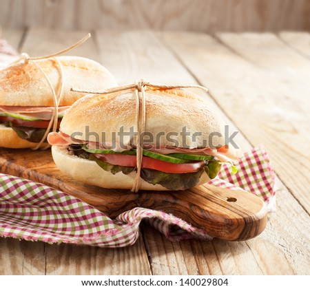Sandwiches with mortadella and vegetables - stock photo