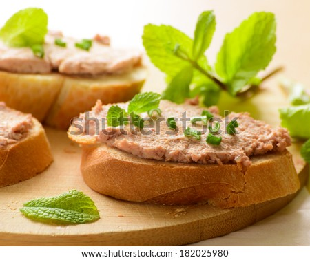 Sandwiches with paste and green onions. Served with mint sprigs. - stock photo