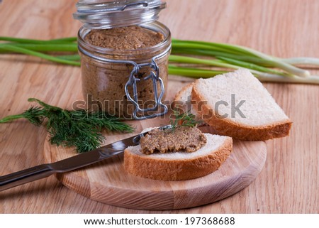 Sandwiches with pate, with glass jar on a background - stock photo