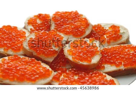Sandwiches with red caviar on a plate