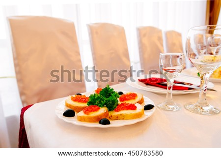 Sandwiches with red caviar. Served table in a restaurant