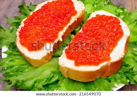 sandwiches with red salmon caviar in a plate - stock photo
