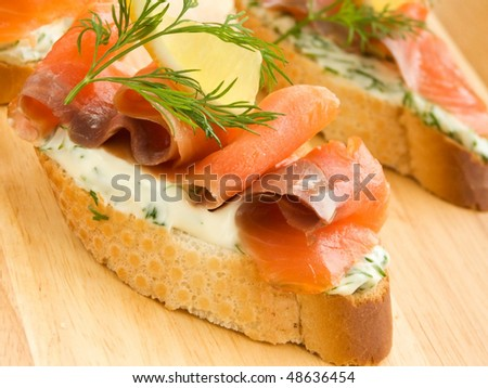 Sandwiches with smoked trout, lemon and fennel. Shallow dof.