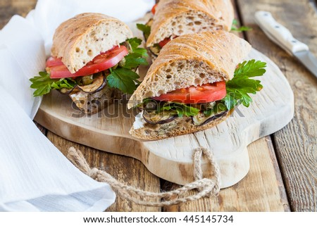 Sandwiches with vegetables on the wooden board