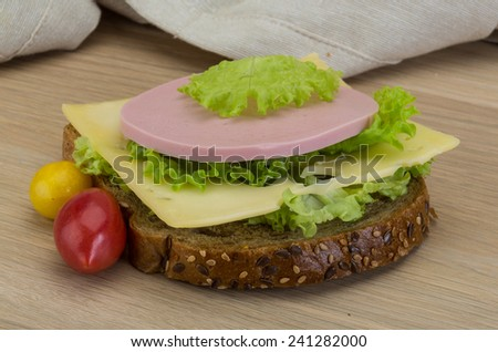 Sandwith with ham, cheese and salad leaves