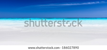Sandy beach and Blue Sky in Summer Day