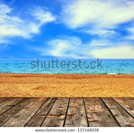 Sandy beach and seascape with wooden floor
