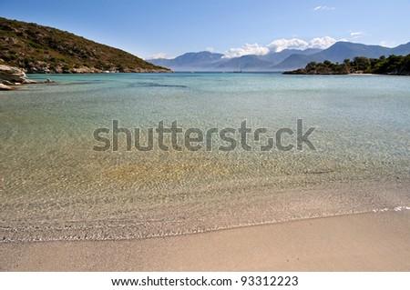 Sandy beach and transparent sea near Saint Florent, Corse, France - stock photo